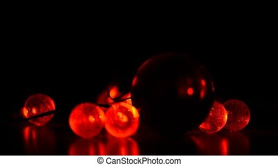 Red garland on a dark background, the light comes on and...