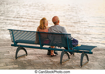 Couple sitting on bench in Ascona Swiss - Ascona,...