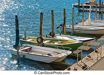 Boats at waterfront in expensive resort Ascona in Ticino...