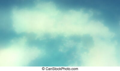 Loopable White Puffy Clouds - Looping animation of a blue...