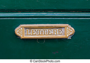 Old Letterbox - Old brass letterbox on a green door