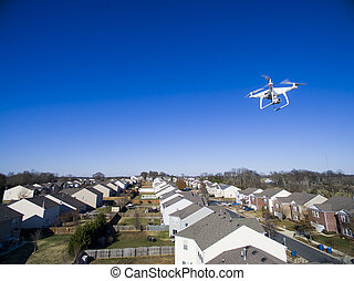 Personal Drone In Action - A personal drone flying through...