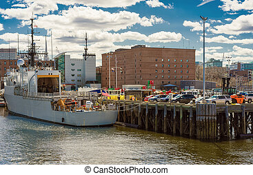 White ship moored near the pier in Boston - Moored ship at...