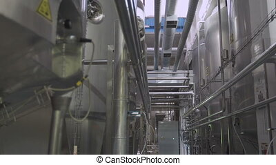 Cisterns and pipes at the dairy factory