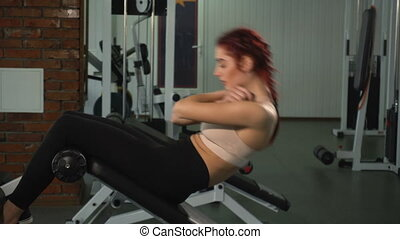 Woman working her abs at the gym - Fit woman working her...