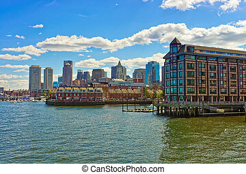 Building near the river and the skyline of Boston -...