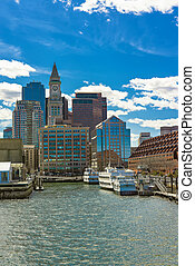 Boston skyline and mooored ships at the pier - Tall building...