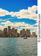 Floating ferry boat with the skyline of Boston in background...