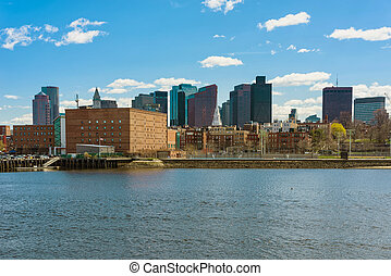 Buildings near river and the skyline of Boston - One of the...