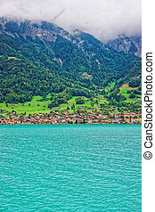 Chalets in Lake Brienz and Brienzer Rothorn mountain Bern Switzerland