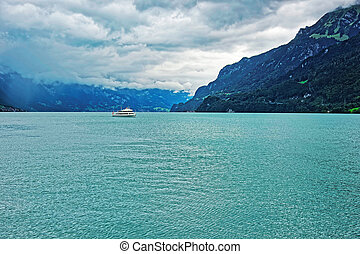 Ferry in Lake Brienz and Brienzer Rothorn mountain Bern Switzerland