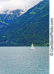 Sailboat on Lake Brienz and Brienzer Rothorn mountain Bern Switzerland