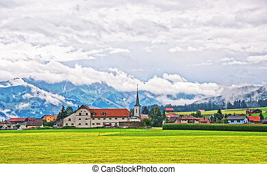 Church of Charmey village on Prealps in Gruyere Fribourg...