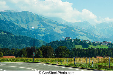 Gruyeres Castle on Prealps mountains in Canton Fribourg in...