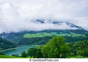 Lake Montsalvens and Prealps in Gruyere district Canton...