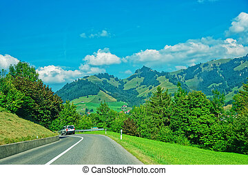 Road and Prealps mountains in Gruyere in Fribourg...
