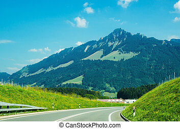 Road and Prealps mountains in Gruyere of Fribourg...