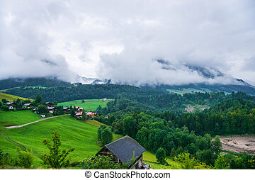 Chalets at Prealps mountains in Gruyere district in Fribourg...