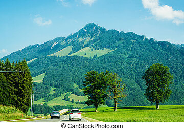 Road and Prealps mountains in Gruyere in Fribourg Swiss -...