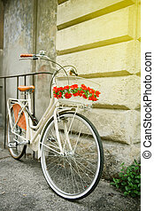 Vintage Flowered bike in Italy sunny day - White vintage...