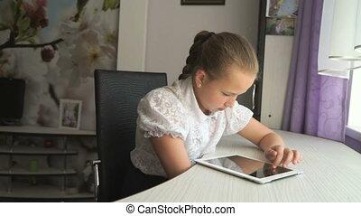 Teenager girl holding a digital tablet computer - Teenager...