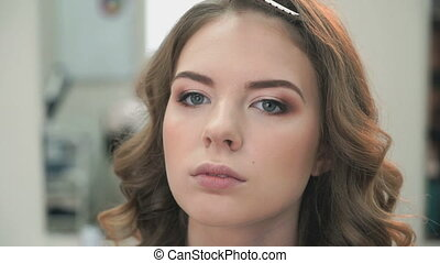 Young model with make-up at the beauty salon