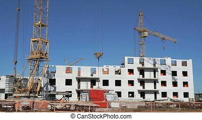 A construction crane delivers the concrete slab - The...