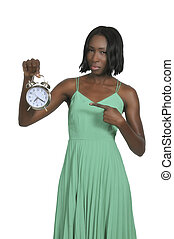 Woman with alarm clock - Woman counting the time on an alarm...