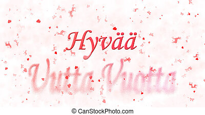 "Happy New Year text in Finnish ""Hyvaa uutta vuotta"" turns to..."
