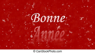 """Happy New Year text in French """"Bonne annee"""" turns to dust..."""