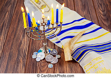 jewish holiday Hanukkah with menorah over wooden table Star...