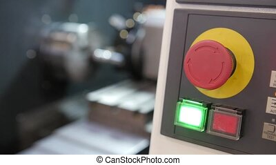 Red button of control panel machine processing of metal, industrial background