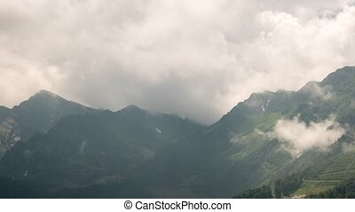 Mountainside in clouds. TimeLapse. Rosa Khutor, Sochi,...