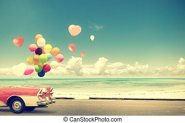 Vintage Car with heart balloon on beach blue sky