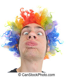 Clown Wig - A white Caucasian young adult wearing a silly...