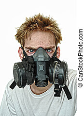 Hardcore Gasmask - A young man wearing a protective gas...