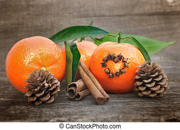 clementines and spices - clementine with cloves in the shape...