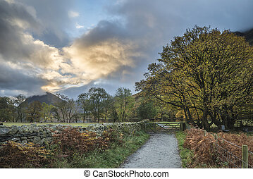 Beautiful Autumn Fall landscape image of Lake Buttermere in...