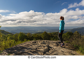 woman over looking the Blue Ridge Mountains after reaching the peak - inspirational view more close in
