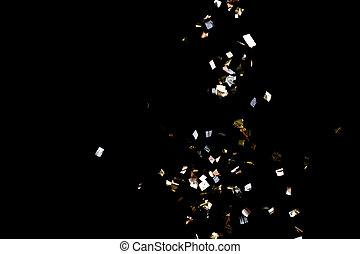 Golden confetti on black background - Golden confetti...