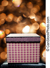 red Christmas gift box on bokeh background