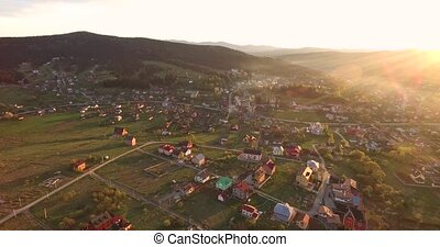 Aerial view. Sunrise over small village