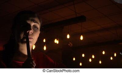Beautiful young woman smoking shisha - Beautiful young woman...