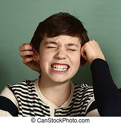 boy being pulled by ears - teenager sister pull her brother...