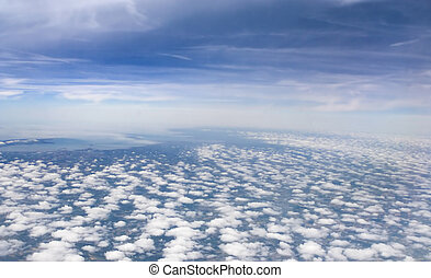 Cloudy - Aeroplane view with thousands of fluffy clouds
