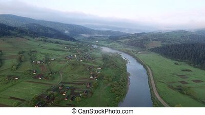 Flying high above the river. Aerial view - Flying high above...