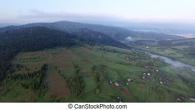 Aerial view. Flying high above the picturesque rolling hills...