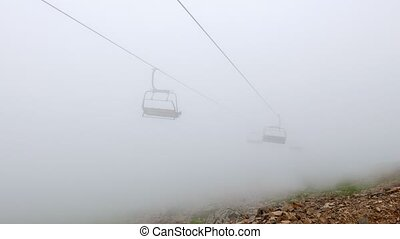 Chairs chairlift in cloud. Rosa Khutor, Sochi, Russia....
