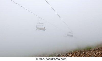 Chairs chairlift in cloud. Rosa Khutor, Sochi, Russia....
