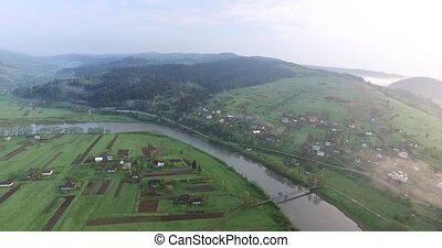 The small town on the hillside. Aerial view - Small town is...